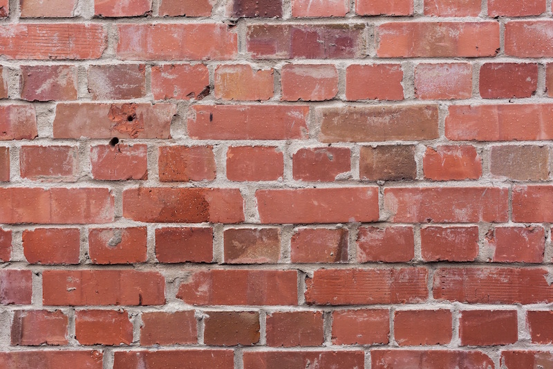 Brick wall with cement mortar
