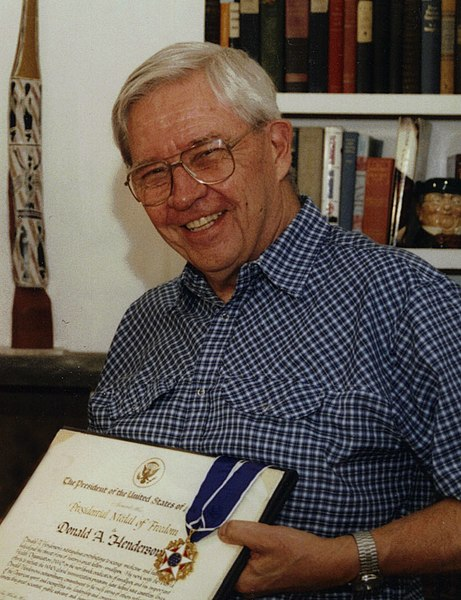 D. A. Henderson holding the Presidential Medal of Freedom, 2002