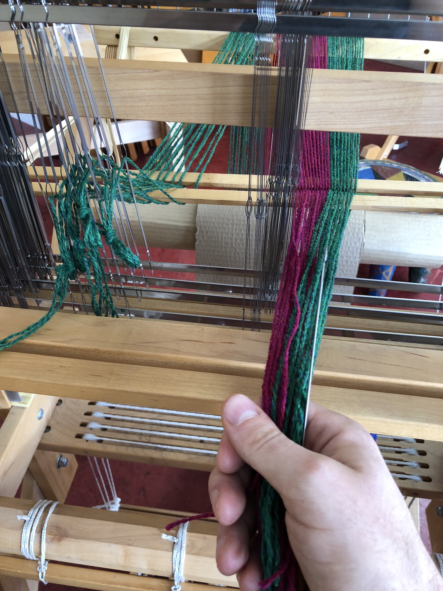 Putting the threads through the heddles