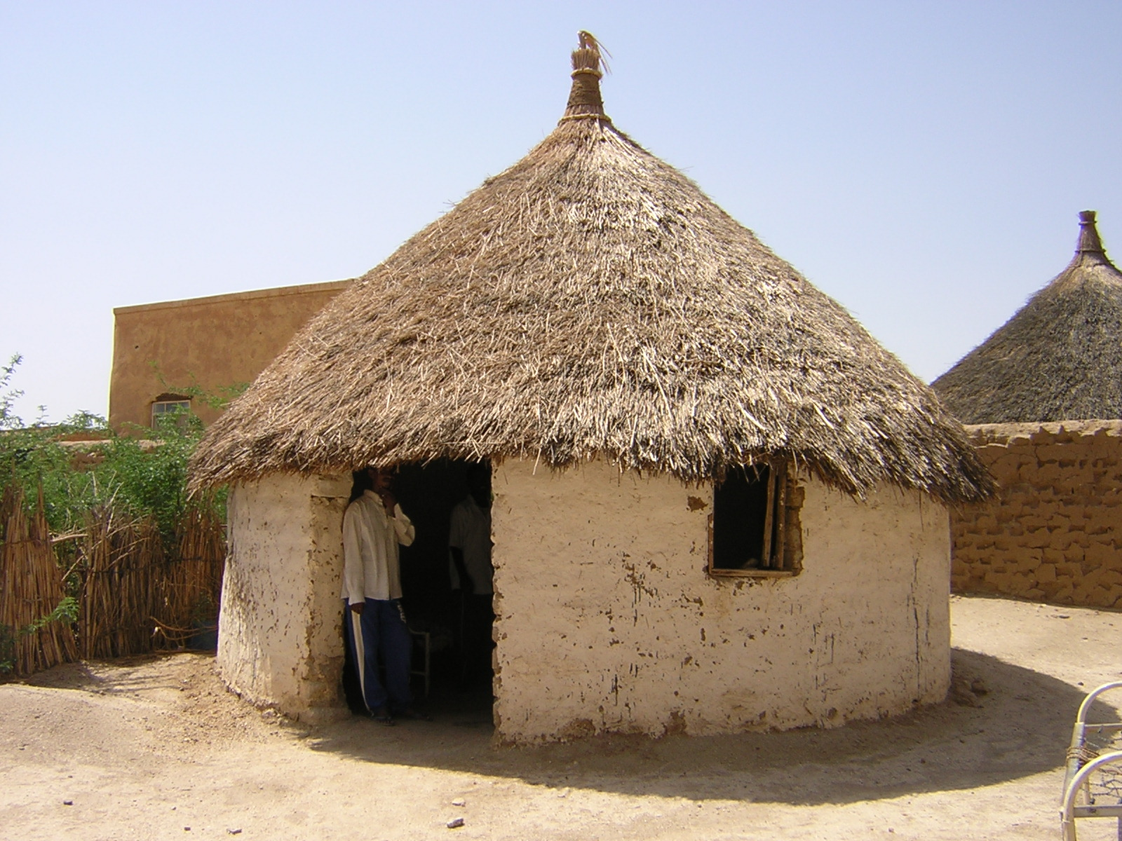 Earthen hut with thatched roof in Sudan