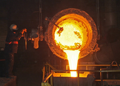 Pouring molten iron from a ladle